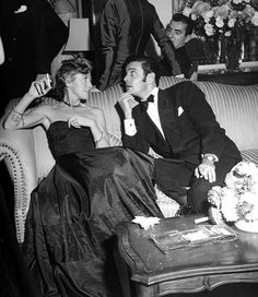 """French actor Louis Jourdan with his wife Bèrthe, nicknamed """"Queque"""" at Samuel Spiegel's New Year's Eve party, Beverly Hills, photo by Peter Stackpole, 1949"""