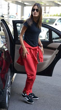 Good look: The brunette beauty opted for comfort in her footwear, rocking some simple blac...
