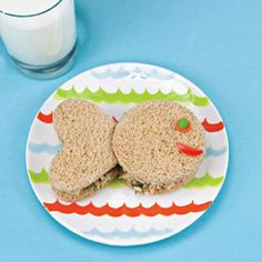 Tuna Fish Sandwich:You'll need circle and heartshaped cookie cutters. Bread  1 (5-ounce) can tuna  Salt and pepper, to taste  ½ teaspoon fresh squeezed lemon juice  Instructions   Stack two slices of bread and cut out the shapes as shown at right.  Drain the liquid from the tuna. In a bowl, mix together the tuna and all the ingredients except the veggies with a fork.  Put a third of the filling in each sandwich, then add the veggies eye and mouth (we used a pea, a carrot, and a red pepper.)…