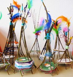Mini woven teepees made by children.. I can't find the correct link but it's made from sticks, cardboard, yarn, and feathers.