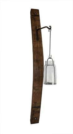These sconces are made from recycled oak wine barrel staves and are sturdy enough to hold hanging planters as well as lanterns. They're ideal for enhancing a warm pub, vino-culture, or nautical themed room.  Please note available lantern styles and stock are subject to availability.  They will hold anything up to 5lbs. Dry Wall mounting kit included.  Get $5 off each sconce when you order 2 or more. (Discount shown in cart)