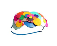 Leather candy headband (cute! so want to make use of leather for crafts...)