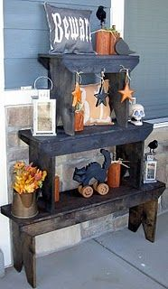 Love this display - 3 benches stacked.  Charming and oh so boo-ish!