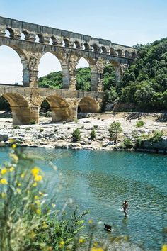 Wild swimming in the river beneath the Pont du Gard, Uzès, France. Photo by James Bedford