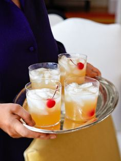 Fresh Whiskey Sours - Barefoot Contessa    3/4 cup Jack Daniel's Tennessee Whiskey,  1/2 cup freshly squeezed lemon juice (3 lemons)  1/2 cup freshly squeezed lime juice (4 limes)  2/3 cup sugar syrup (see recipe)  Maraschino cherries