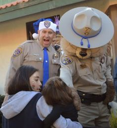 Officer Matther Hunt and Chipper, the CHP Chipmunk greeting children. Photo by:  Gary Martin