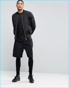 ASOS Black Men's Leggings styled with shorts and a bomber jacket.