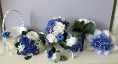 Blue & white silk Roses, Agapanthus, Cornflowers, Setpanotis and sweetpeas wedding flowers. Bouquets and buttonaries Hand made by Pink Moon flowers.