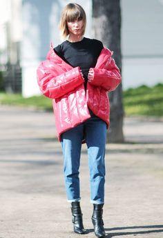 Anya Ziourova wearing a red puffa Balenciaga jacket and black Pierre Hardy Leather Boots.
