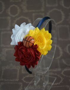 A personal favorite from my Etsy shop https://www.etsy.com/listing/254193643/cleveland-cavs-headband-cavs-hair-bow