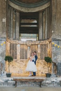 The Asylum in London wedding venue with exposed brick -   mage by Mckinley Rodgers - An alternative industrial shabby chic venue for a London city wedding with yellow colour scheme and reused wedding bouquets as table centres and reception decor