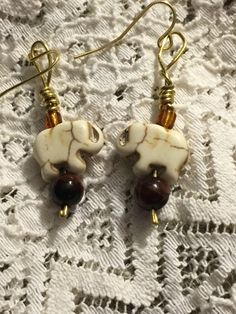 They say an Elephant never forgets. Never forget to stay nimble, and always keep your balance. These Ivory colored stone Elephants Stand atop a Red...