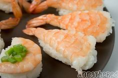 How to prepare shrimp for sushi.  That's how they make it stay flat!