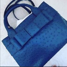 "🚨PRICE FIRM Kate Spade Blue Ostrich Bag 🔅Host Pick 7/31 pretty flirty and girly party🔅11.9""h x 15.4""w x 6.2""d drop length: 8"" MATERIAL ostrich embossed cowhide with matching trim custom woven kate spade new york lining 14-karat light gold plated hardware DETAILS tote with open top center dividing zipper compartment, zipper pocket and double slide pockets light gold kate spade new york staple item comes with dust bag 🚫NO TRADES. Please use the make an offer function as I do not negotiate…"
