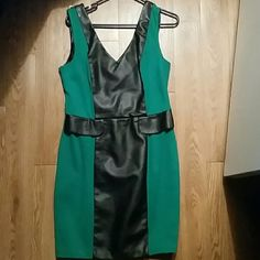 Emerald green sexy vegan leather  dress This dress is so sexy.  Emerald gree color with black vegan leather strip down  middle.   Zips in back.  You will love this dress. XOXO Dresses