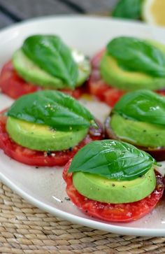 Avocado basil heirloom tomato caprese salad, healthy tasty bite size appetizer snacks