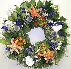"""Catalina Island is made of air-dried Salal, Echinops, Blue Larkspur, Ammobium, Huckleberry Twigs, Safflower, and delicate Tree Fern, with a sprinkling of real starfish and sand dollars. 24"""" 30"""""""