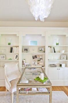 serene and sophisticated office.  capiz shell chandelier, brushed nickel desk, and crisp white bookshelves.