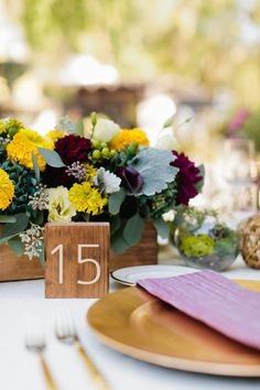 these tablescapes add a tailored element with boxed florals and simple block table numbers  Photography by http://erinheartscourt.com, Wedding Coordination by http://inthenowweddings.com, Floral Design by http://rosebudfloraldesign.net