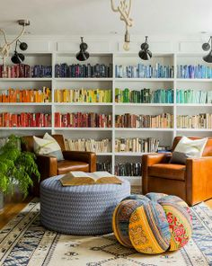 Colour-coordinated bookshelves: Eclectic Suburban Home by Hudson Interior Design on Homeadore