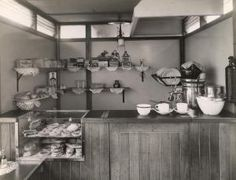 "iew of the counter of a mobile canteen, showing cakes and tarts on display under glass and, on the open shelves, goods such as Bryant & May matches, Aero chocolate, and sweets including those by Maynards and Nipits; the latter are ""voice, throat & chest pastilles"".    Photographed by Topical Press, Apr 1938"