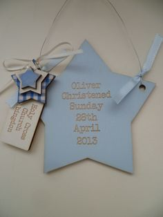 Wooden christening star with wire and star embellishments.
