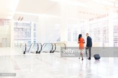 Stock Photo : Business people walk through large  modern space.
