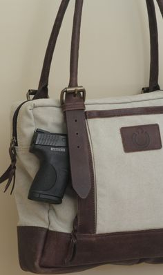 Designer Concealed Carry. not pictured. Pleated tote canvas/sage, leather straps/trim