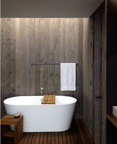 a modern zen-like bathroom-if I had this bath I'm not sure that I would ever get anything done because I would soak all day...