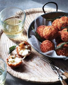 Arancini with Sage: The Sicilians are credited with the invention of arancini: fried cheese-stuffed rice balls that rely on the mozzarella typical of Southern Italy. #sicilianfood #arancini #sicilia #sicily #arancine