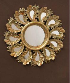 Espejo dorado plumas    Medidas:  42cm de diametro    Iva incluido