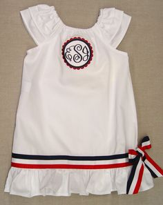 Celebrate 4th of July in style! Peasant dress in white swiss dot with monogram applique. www.justduckyoriginals.com