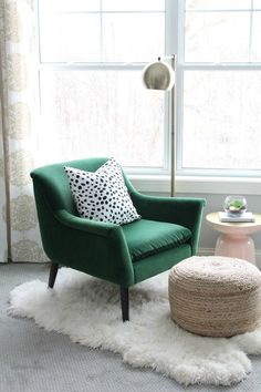 cosy reading nook with green armchair polka dot cushion and white fur rug