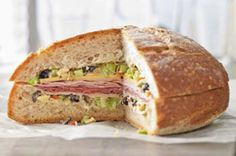 Muffuletta, a Sicilian sandwich that New Orleans has come to adore, consists of a 10 inch round loaf of bread, hollowed out and then filled with Italian salami, a vital olive salad, cheese, Italian ham, and freshly minced garlic. Because a true Muffuletta Sandwich is never toasted or heated, it's perfect for a Super Bowl buffet table. Enjoy!