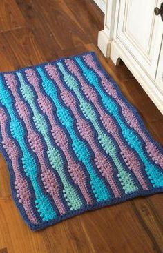 Crocheting With Two Strands Of Yarn : Textured Waves Rug Crochet Pattern is worked with 2 strands of yarn ...