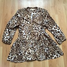 Michael Kors Blouse NWT Leopard print with gold button detail. Flowy peplum design. 3/4 sleeves with button closure. Michael Kors Tops Blouses