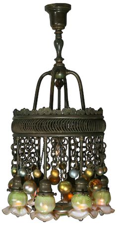 Louis Comfort Tiffany - (1848-1933) - Favrile Glass and Bronze Eight-Light Moorish Chandelier. Circa 1899-1920.