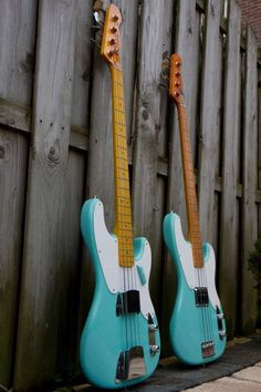 basses, not quite twins. Epiphone makes some like this: 4, 5, 6 string veriety. Need a nine string Fender. May have to be custom made.