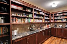 Holy cow that's a huge walk-in pantry. I like the deeper shelving space for cookbooks and larger appliances.