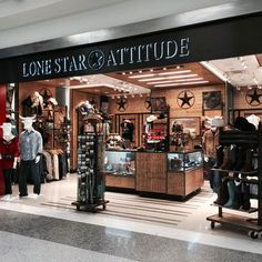 Lone Star Attitude - Designed for Paradies Shops and Gifts at DFW Airport Terminal E. Opening date: Dec. 2014 - Cowboy chic apparel store. Lead Designer: Hilda Rodríguez.