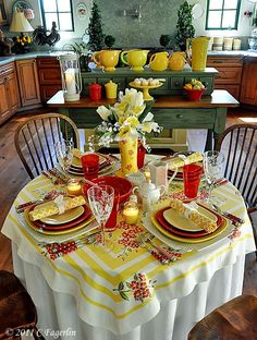 adorable yellow, white and red tablescape with vintage table cloth - take a look at the polka dot and gingham flatware
