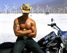 Hunky Cowboy On His Mechanical Horse