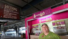 Erik Lingren, owner of Menchie's Frozen Yogurt at PNC Park, stands in front of his kiosk at Section 107 (Pittsburgh, PA)