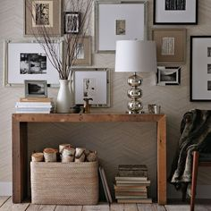 Good tip for narrow hallway, do not over crowd, take it vertically up. A narrow console table with beautiful assortment of art and lots of wood texture. Interesting and so crisp!