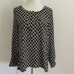 Black and White GAP Blouse Black and white chain link pattern. 3/4 button down and flap pockets. Fits a 34 C . GAP Tops Tunics