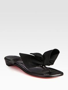 I'm a sucker for sandals with a feminine flare.   Christian Louboutin Leather and Nylon Bow Thong Sandal