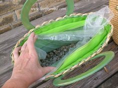 Cut the bag to size and insert into the purse. Then add about 2  of pea gravel into the bottom.