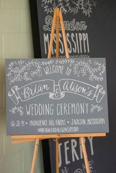 chalkboard style welcome sign on wooden easel