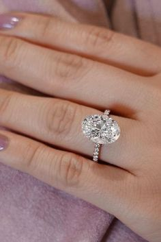 24 Oval Engagement Rings That Every Girl Dreams ❤ oval engagement rings pave band white gold center diamond ❤ More on the blog: https://ohsoperfectproposal.com/oval-engagement-rings/