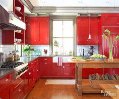 Oversize white subway tile provides contrast to bold, red cabinetry. The combination of colors makes the farmhouse-style kitchen feel fresh and new! http://www.bhg.com/kitchen/backsplash/subway-tile-backsplash/?socsrc=bhgpin041915contrastingkitchentile&page=2